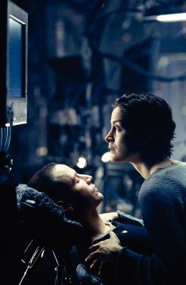 "Keanu Reeves and Carrie-Anne Moss in ""The Matrix"" 1999. Created by Andy & Lana Wachowski"