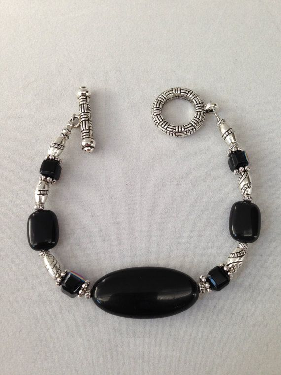 Black and silver bracelet on Etsy, $16.00