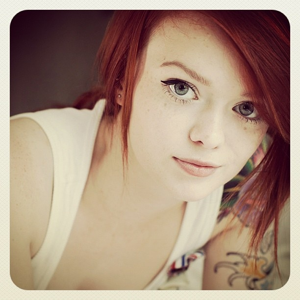 Short haired redhead tattooed