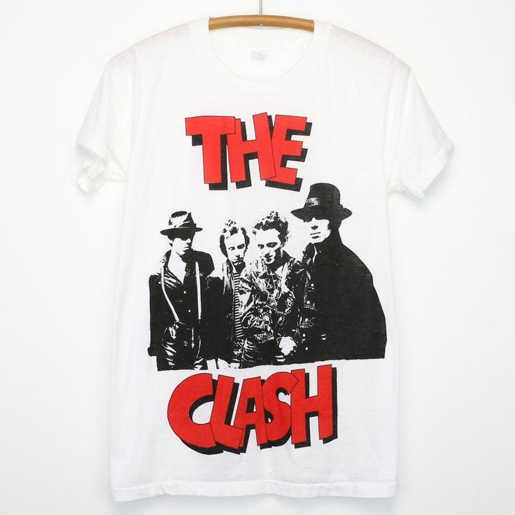 Original1970s The Clash Shirt. This is a true vintage shirt, not a modern reproduction. Sizes vary so please use measurements for best idea on fit. No Back Graphics. Shirt is ingoodcondition, no holes, tiny dot on front.