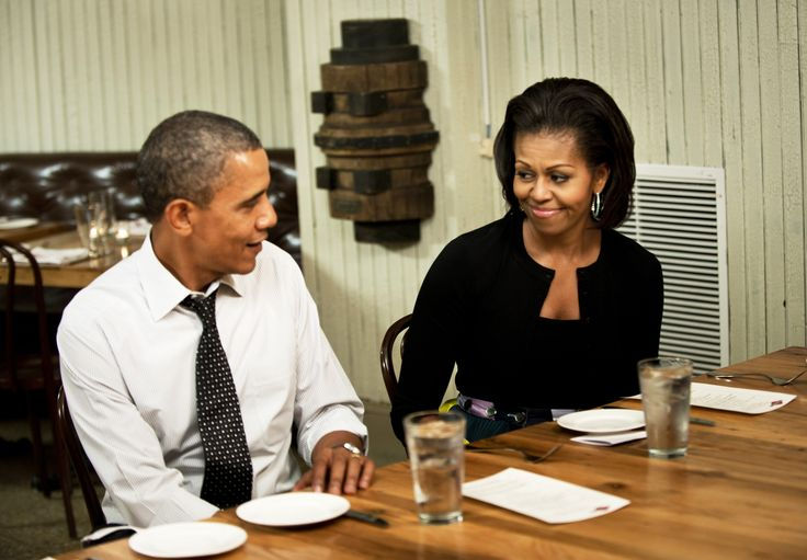 President Obama is totally getting 'the look' from his wife. I wonder what he said...
