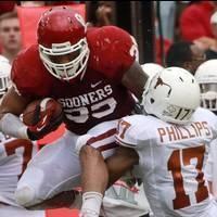 Oklahoma destroys Texas in highlight-reel show 63-21