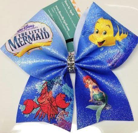 Bows by April - Full Glitter Little Mermaid Cheer Bow, $20.00 (http://www.bowsbyapril.com/full-glitter-little-mermaid-cheer-bow/)