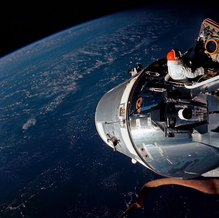 Astronaut Rusty Schweickart, lunar module pilot, is photographed from the Command Module ''Gumdrop'' during his extravehicular activity on the fourth day of the Apollo 9 Earth-orbital mission in March 1969. The Command and Service Modules are docked with the Lunar Module.<br />