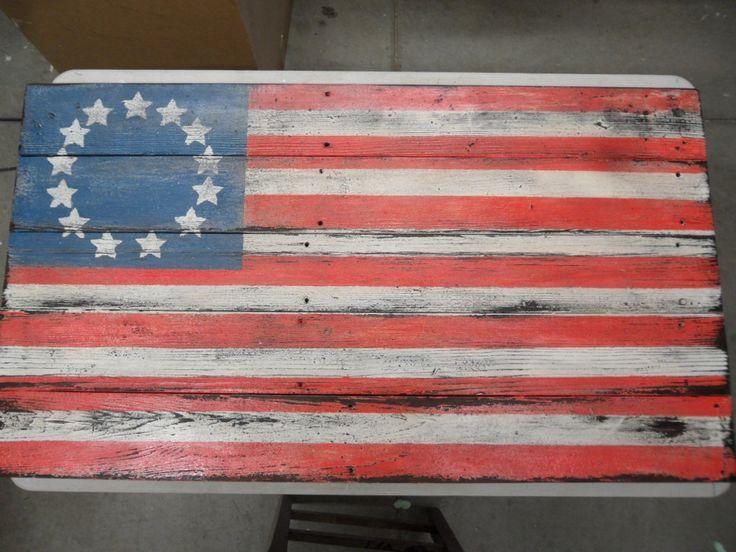 primitive flag, barnwood flag, barnwood flooring, distressed flag, wall art, rustic flag, americana decor. $99.99, via Etsy.