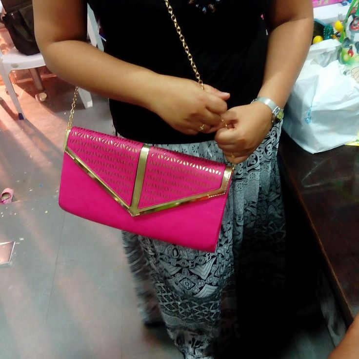Lakshmi created a post - Funky pinky sling bag cum clutch that compliments ur style. For price, whats app to 9963473004