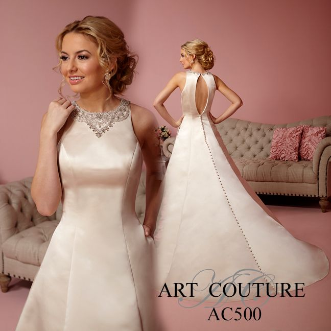Satin Aline bridal gown with high encrusted neckline, key hole back with button back drama and pocket feature. AC500 is available in Café as pictured, Ivory or White. Call us to find your nearest retailer. #eternitybridal #artcouture #artcouturebridal #weddingdress #weddingdresses #bridal #brides #bridalgown #gettingmarried #weddingshopping #weddingdressshopping #bigday #weddingday #dresses #satinballgown #regal