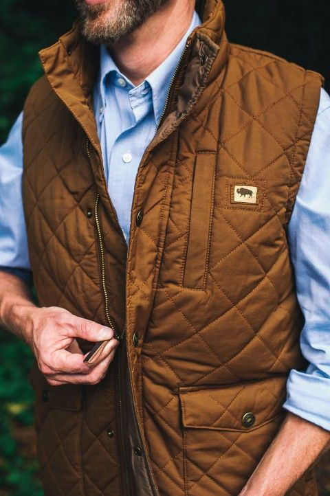 This men's quilted vest is waxed and washed, giving it a broken-in look that still maintains the wax coating. Basically, it's magic. Layers great with an oxford or a flannel, jeans and boots. Also available in navy. Shown here in camel.