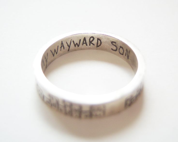 Supernatural cityscape etched silver ring with 'Carry On My Wayward Son' inscription. $32.13 via Etsy.