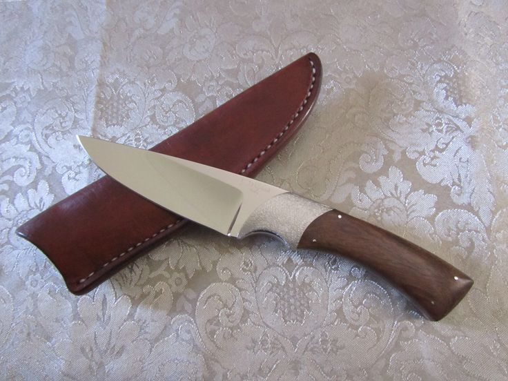 12C27Mod Stainless Steel Blade with Tambotie handle & handmade leather sheath.