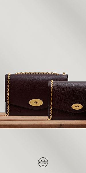 Shop the Large Darley in Oxblood Leather at Mulberry.com. The Darley is iconic with the Mulberry signature postman's lock, available in a variety of signature and seasonal colours including statement brights and heritage shades. The larger Darley is a perfect day-to-evening bag, featuring a zipped internal compartment and eight credit card slots surrounded by luxurious nappa lining.