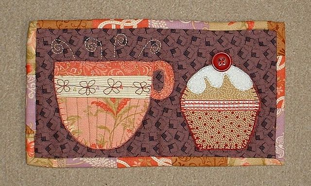 My very first mug rug pattern - Tea and Cake.  Quick, easy and stunning.  I have made many in all different colours.  It was inspired by the Patchwork Pottery's teacup pouch (see this board).