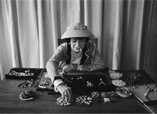 coco chanel designing her own jewelry (also, looks like me on a many a Saturday night without the cigarette)