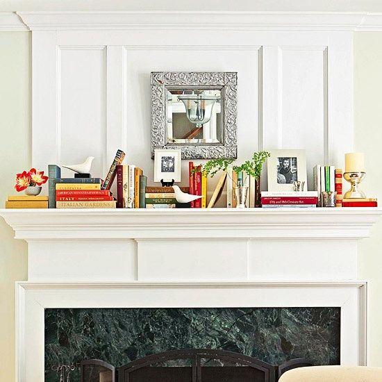 Home Decorating Tips - Give Objects a Lift: Use books as graphic, colorful pedestals to give framed photos and other treasured objects a lift. Alternating horizontal and vertical stacks of books add interest to this mantel. Try the same idea on any shelf or down the center of a table.