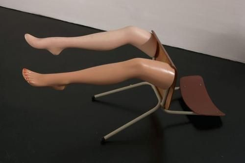 "Amie Dicke. Drop Dead, 2007. Chair and plastic mannequin legs, 24 x 17 x 18"" (61 x 43.2 x 45.7 cm)."
