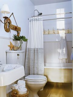 Delightful details like vintage hooks over clawfoot tub, cute curtain,  basket for towels · Decorating Small BathroomsLinen ...