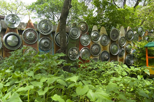 Neat idea for a garden space, old ironing boards and hubcaps. Austin Art Yard Tour by stitchindye, via Flickr