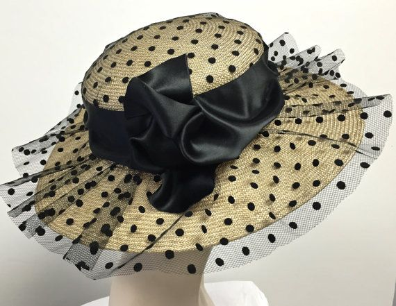 Kentucky Derby hat black and Natural straw women hat hand blocked by traditional millinery techniques. Trimmed with black tulle embossed with small black polka dots. Beautifully trimmed with 4 inch double faced satin - center bow very pleasingly hand shaped. Inspired by the spring designs of the Chanel spring runway. Very romantic look! Inside band has an enclosed ribbon to adjust for your day to day comfort. This hat can be custom made in many colors. Please convo me and I will set up a…