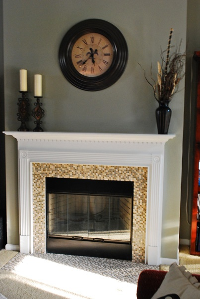 fireplace redo for our living room, larger tiles on the floor though