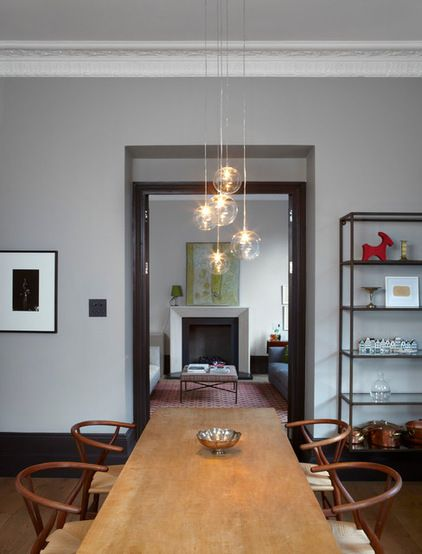 Modern Dining Room By Sigmar   Light Globes Over Table
