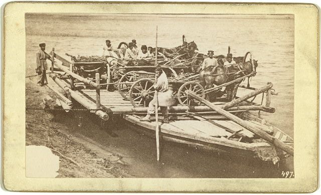[A ferry loaded with people and wagons on a Russian river(?)]
