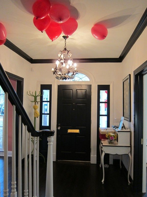 Matching black trim along the molding, door frames, banister and windows = perfection!!