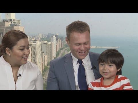 Christopher Helt immigration attorney with Honduran refugee boy Iker Velasquez on Univision Miami television interview May 30, 2015.