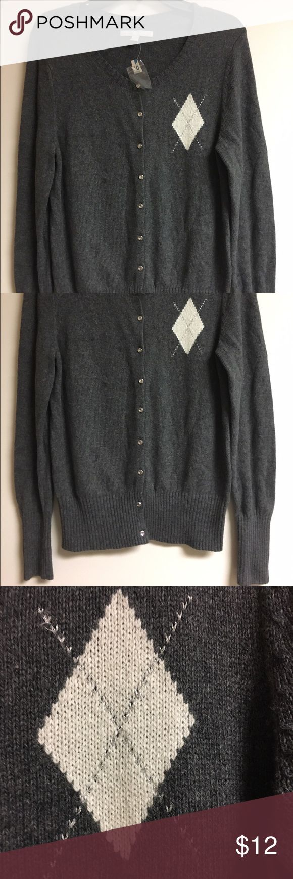 New Old Navy Gray Button Up Cardigan Sweater Large Brand new Old Navy gray Button Up Cardigan Sweater size large. Excellent condition, never worn. No holes, no stains, no flaws of any kind. Check my other items for bundles! I'll be listing about 200 items in the next week or so. I have entirely too many clothes and I'm running out of closet space! Time to consolidate and find new homes for all these pieces. All items come from a smoke free home. Offering a 10% bundle discount on 3+ items…
