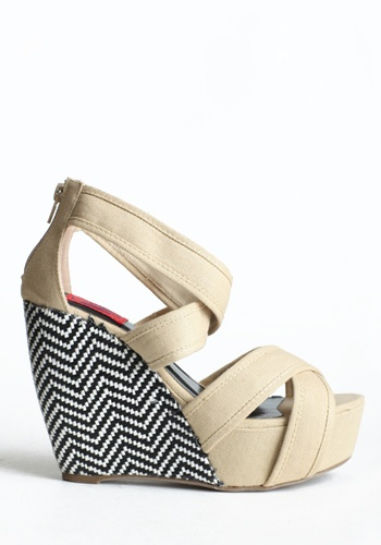 Tan, strappy wedges with a black and white chevron patterned heel!