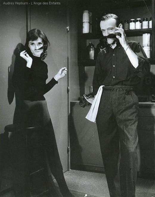 Fred Astaire and Audrey Hepburn. Haha, it's good to know that even then, pretending to have a mustache was A-OK