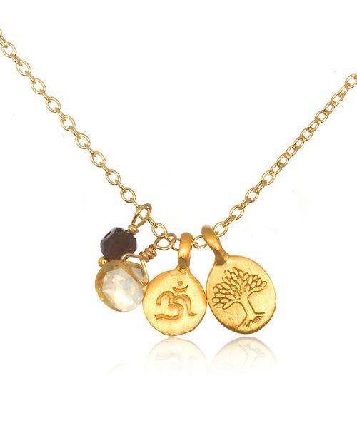 【Satya サティア】Quest For Truth Necklace    真実の探求者のためのオーム(OM)ネックレス。    4つの魅力ある要素が散りばめられた上品で価値のあるミニ・チャームネックレス。スモーキートパーズは、開放性を表し、神秘の音節・紋章である宇宙の聖なる音と言われるオームと生命の樹を意味するシンボルのチャームがあります。