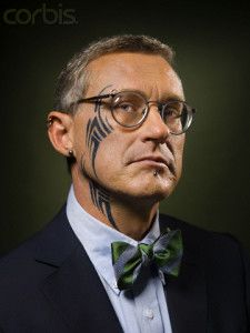Businessman with tattoo and piercing.