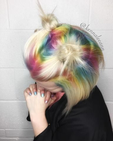 "Kenna Dupuis (@kennaleeann_hairstylist) put together a look meant to ""turn heads"" on co-worker Hannah McKay (@dolledupbyhannah). Hannah came to Kenna with an idea of doing pastel rainbow roots. They bounced ideas off one another to make sure that the hair would look great no matter where Hannah parted her hair. After considering many different techniques, they decided to combine their two favorites. Hannah formulated the pastel colors and then Kenna made her idea become a reality. Hair wa..."
