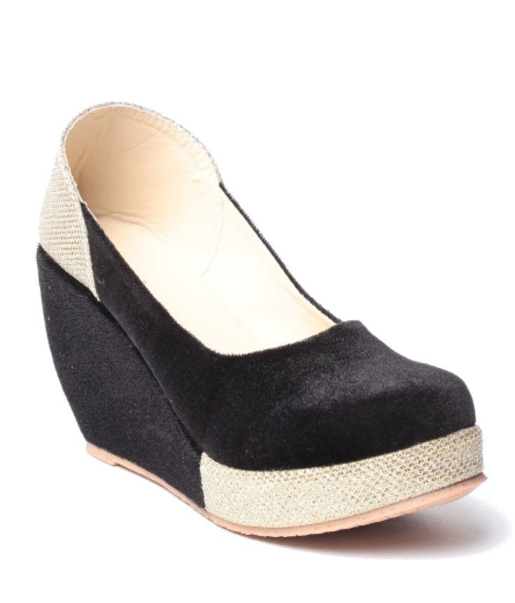 Loved it: Anand Archies Black Wedges Slip-on Heels, http://www.snapdeal.com/product/anand-archies-black-wedges-slipon/918997453