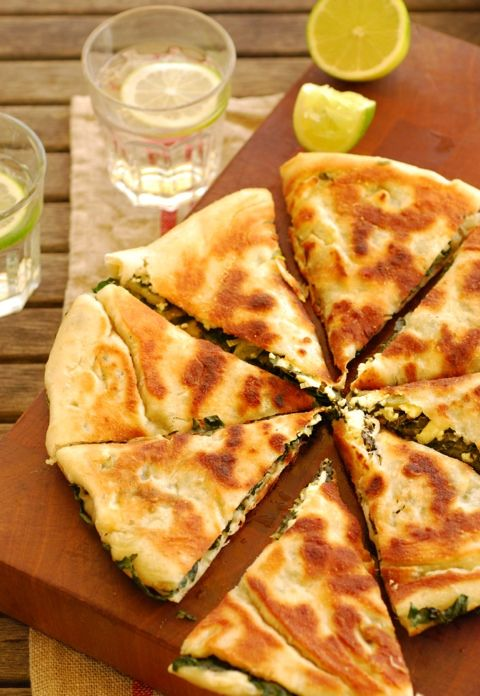"""gozleme""  So what is a Gozleme? It's a pizza like dough rolled really thinly then filled traditionally with spinach and feta cheese or spicy minced meat. Turkish food"
