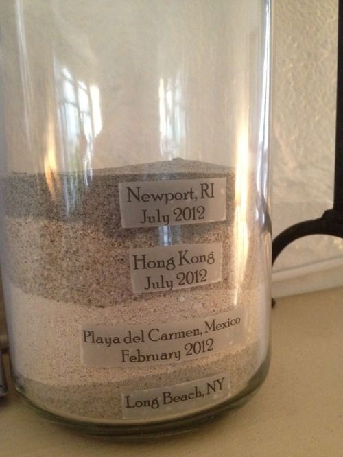 vacation memories: layers of sand labeled & dated from beaches you've visited