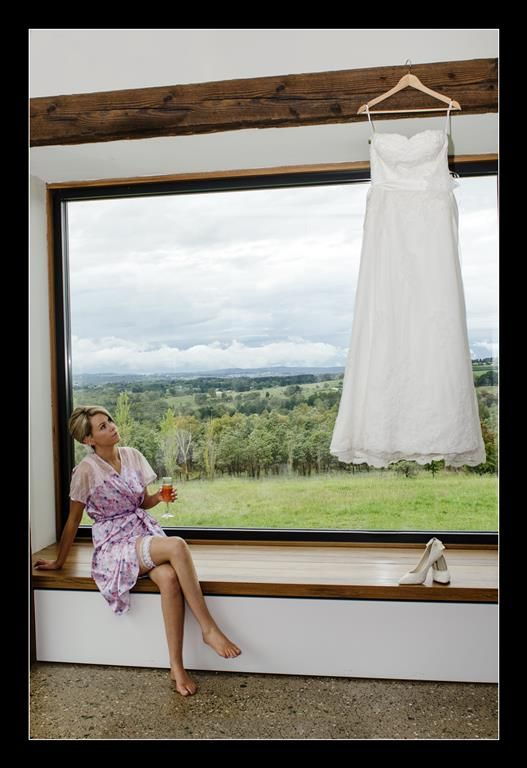 Candid Photos of a Lifetime - Big window... stunning wedding dress... beautiful bride   Borrodell Vineyard, Orange www.candidphotosofalifetime.com.au