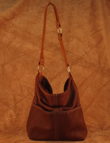 The Bucket Bag. This deerskin purse comes in red, turquoise, brown, black, cream, pink, and saddle tan. This purse also comes with a small strap extension to create a cross-body bag instead of just a shoulder bag. #leather #Canada #handmade #Rockwood #Ontario #like #daily #fashion #hidesinhand