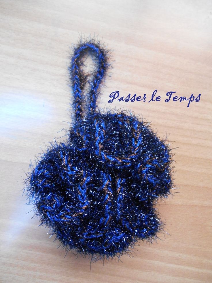 Crocheted bath-puff.  Easy pattern, crochet a magic loop, then 15sc into the loop, then 3dc in each sc, then 2 or 3tc in each dc. Crochet a chain to hang. Use acrylic yarn.