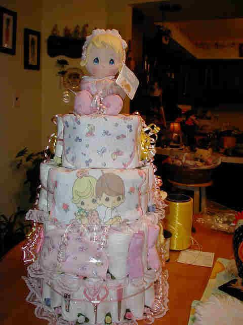 Precious Moments diaper cake. Love everything except the doll on top