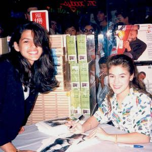 A 15 year old Eva Mendes gets autograph from a 17 year old Alyssa Milano in 1989