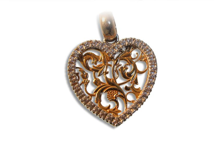 18 KARAT GOLD FILIGREE HEART DIAMOND PENDANT.
