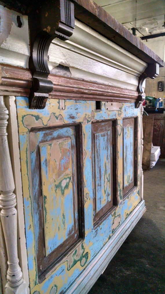 Reclaimed door and other vintage architectural pieces turned bar. | Would make for a great cashier/checkout in an antique shop, a rustic vintage store, etc...