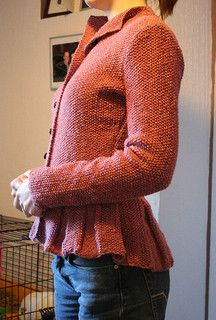 A fitted moss stitch jacket with contrasting horn buttons and peplum that dips to the back. Knitted in Rowan Felted Tweed