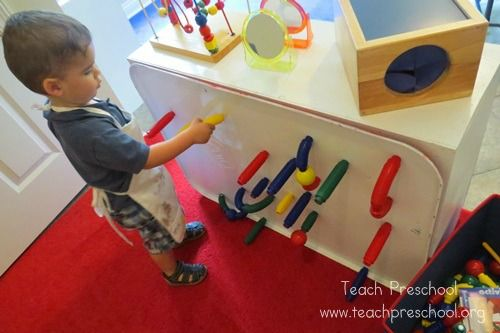 "cover old ugly shelf back with magnetic ""oil pan"" board   The first day in summer preschool 