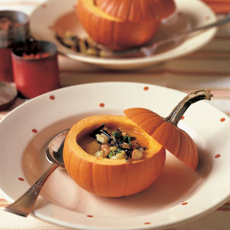 'Small Sugar Pie' pumpkins are ideal for holding hearty servings of pumpkin soup, garnished with cooked wild rice, toasted almonds, and apples -- though it's just as delicious served in a regular soup bowl.