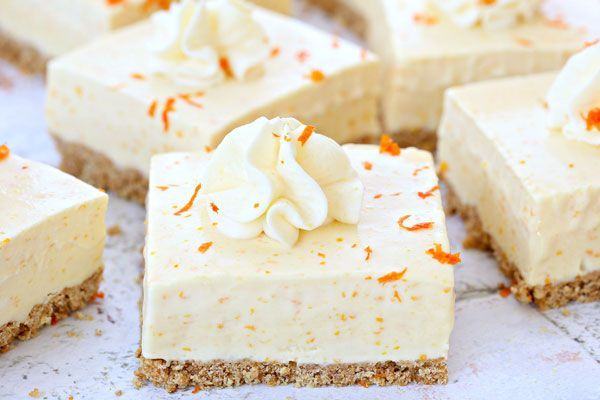 Summer in a bite, these Orange Dreamsicle Bars are packed with orange flavor from freshly squeezed orange juice and grated orange rind.