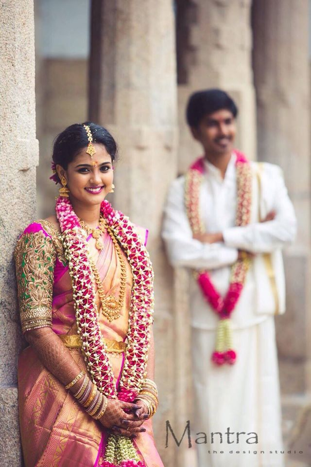 South Indian bride.Gold Indian bridal jewelry.Temple jewelry. Jhumkis. Pink silk kanchipuram sari.Braid with fresh flowers. Tamil bride. Telugu bride. Kannada bride. Hindu bride. Malayalee bride.Kerala bride.South Indian wedding