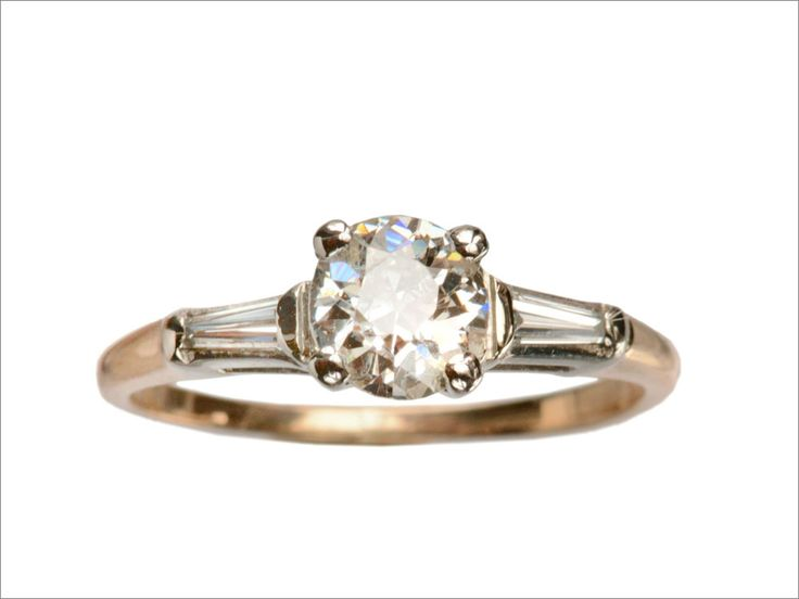A classic mid-century engagement ring design, but rare to find in yellow gold.c1955 0.70ct Old European Cut Diamond Engagement Ring