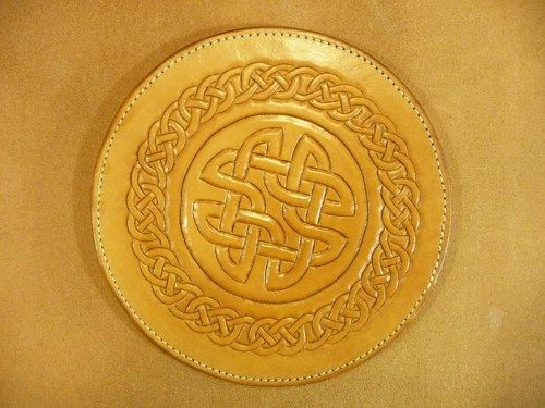 hand_carved_leather_round-tuit_or_hot_pad_w_suede_back_6e0a1ef5.jpg (500×375)